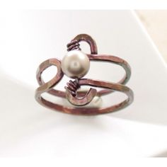 This cute copper ring with golden cream Swarovski pearl hand forged with 14 gauge solid copper wire that was hammered for more style and durability.