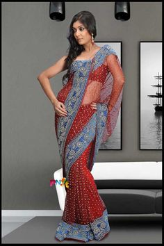 Gorgeous red net bridal saree with a vivid blue border. Love it!