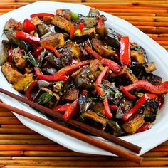 Sriracha-Spiced Stir-Fried Tofu with Eggplant, Red Bell Pepper, and Thai Basil; if you have garden eggplant, this recipe is not to be missed! [from KalynsKitchen.com] #Eggplant #Tofu #GlutenFree #LowCarb