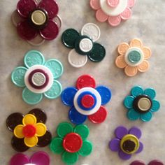 For those who work in the hospital or pharmacy...medication vial tops used to decorate plain badge holders.