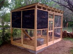 Medium chicken coop - modern design with ancient techniques - charred cedar to keep out insects and mildew