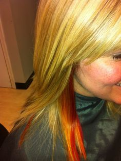 yellow, orange, red peekaboo blonde highlights