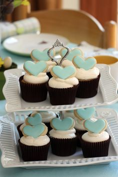 Cupcakes with heart sugar cookie toppers. Perfect for a bridal shower.