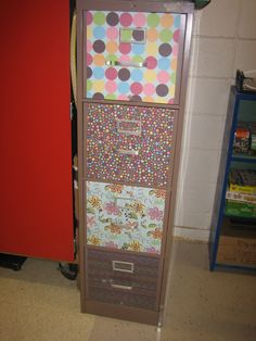 scrapbook paper and modge podge! I love this for making the classroom look more homey