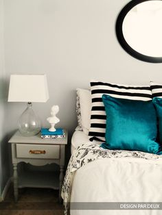 black white & teal bedroom. liking the contrast in prints