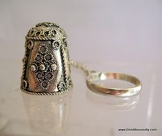 Silver Afghan thimble, with ring to enable the bride to pin it to her viel.