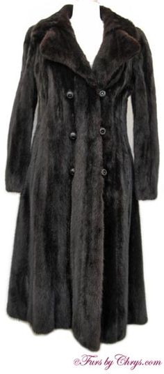 """Black Mink Coat #BM717; $1200; Very Good Condition; 2 - 6. This is a stunning genuine dyed black mink fur coat. It has an Emilio Gucci label and features a double wing-style collar which gives the appearance of a large notched collar. It has a magnificent 94"""" sweep which creates a very dramatic drape. The closures are black buttons with dazzling black rhinestones (all rhinestones are present). This glamorous black mink coat would be fantastic to wear to your more formal events. Enchanting!"""