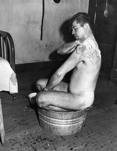 Russell Lee, American Mining Communities, Miner taking a bath in too small a tub.