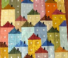 I REALLY want this pattern!  Log cabin houses :)