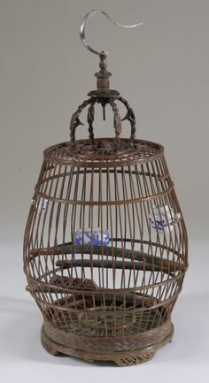 Antique Chinese birdcage with tiny blue & white porcelain cups inside.
