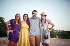 Ashley Blue, Carolyn Stotts, and Carolyn Van Houten stand on Playa Mann, Galapagos, with their coach Steven King. Rachel Dennis/reesenews
