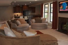 traditional basement finished with fireplace and second kitchen