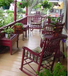 This porch is beautiful!  Love the color...look at all the pretty plants, rocking chairs....love it!!