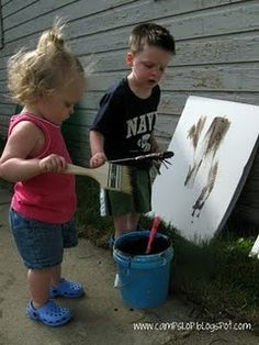 mud painting, white painted wood, rinses clean for repeated painting!