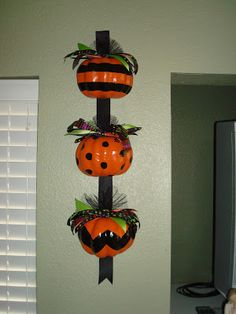 Ugly Dollar Store pumpkins turned into cute Halloween decor. Tutorial.