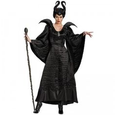 A floor-length black gown with ribbed details, over-exaggerated shoulders, a detachable brooch on the bodice, and Maleficent's signature horned headpiece.