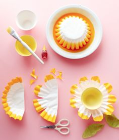 Coffee Filter Flowers... This would be so cute to do for a kid's flower/garden themed birthday party... use them for decorations, or attach small paper cups to the center and fill with candy, a chocolate cupcake, or other snacks!