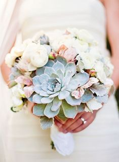 Bouquet of blushing bride proteas, roses, echeveria, gardenias, velvet leaves, and dusty miller | Brides.com