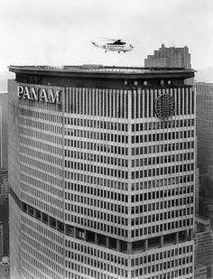 A passenger helicopter of New York Helicopter Airways lands at the Pan Am Building heliport