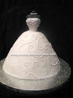 Homemade Bridal Dress Cake: This Bridal Dress Cake was made from a Wilton wonder mold pan. I used about a box and a half of pound cake to make the skirt, (dress).   I covered the