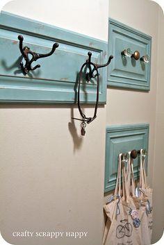 Repurpose old cabinet door and drawer fronts as coat hangers