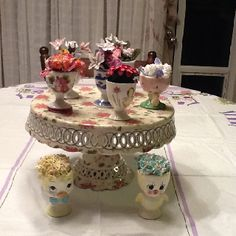 Vintage egg cups and flowers. My new Spring centerpiece.