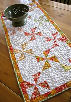 """pinwheels quilted table runner, table topper featuring """"Marmalade"""" by Bonnie and Camille for Moda"""