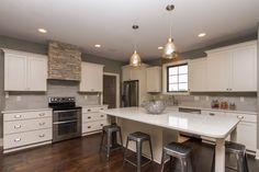 Bella homes iowa kitchens on pinterest travertine hoods for Kitchen designs centurion