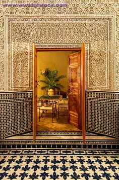 Sublime workmanship in this #Moroccan Riad: mosaic zellij tile on lower wall, topped with carved geps plasterwork. Glazed bejmat tiles on the floors. Moroccan Riad Cle De Fes, Fez.