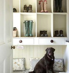 The cubby holes in this backdoor mudroom have carpet swatches inside to help remove dried mud from work shoes. | Photo: Mark Scott | myhomeideas.com