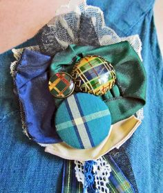 Tartan flower brooch made with vintage buttons, lace and tatting.