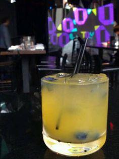 Mango Pez Candy Cocktail {Rum, Mango Juice, Mango Slices, Sugar, Prosecco, & Blueberries Garnish}