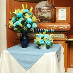 Ships display menorahs and fresh flower arrangements decorated in blue, silver and white to celebrate Hanukkah.