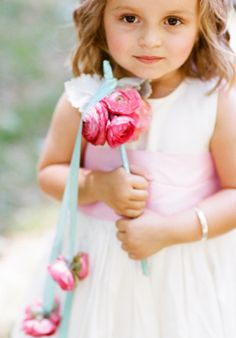 A baton is another fun #flowergirl alternative to a traditional basket. Love how this one includes hanging buds!
