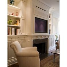 Low Fireplace With TV above for bedroom.