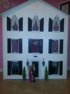 Custom Designed Barbie House, Three story white house with black shutters and roof.