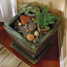 This is just another example of the container filled with water and rocks, with a submerged pump. Those of us with toddler-aged kids need water features that are completely drown-safe, and I think this counts. Not to mention it's pretty cheap and DIY-able.