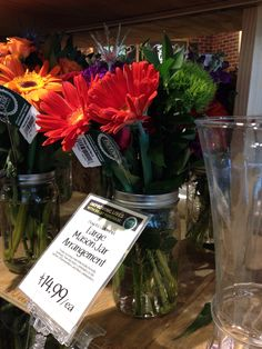 fall flower centerpieces in large Mason/Ball jars just $15! (Whole Foods Annapolis)
