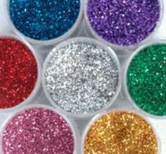 sugar glitter-/4 cup sugar and 1/2 teaspoon of food coloring mixed, bake10 mins in oven on 350* to make edible glitter