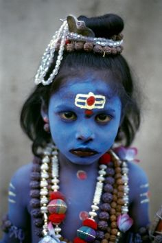 National Geographic photo of a Hindu boy dressed up as Lord Shiva in India.