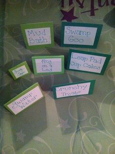 Frog Theme Baby Shower Tags: Mud Bath - Fondue Fountain, Swamp Goo - Green Jello, Frog Eggs - Green Grapes, Frog on a Log - Ho Ho's with green gummy frogs on them, Leap Pad Cupcakes - Cupcakes, Swamp Water - Ginger Ale, Crunchy Treats - Rice Krispy Treats