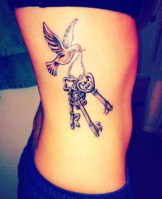 Keys dove rib tattoo for girls