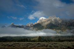 Located just south of Yellowstone, Grand Teton National Park in Wyoming offers some of the most photogenic mountains in North America. The mountains can be photographed from roadside if you drive along highway 26.