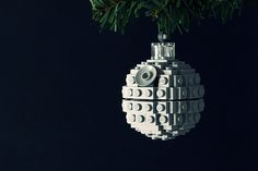 Chris McVeigh posted instructions for building the ultimate geeky christmas ornament - an adorable death star made from legos. Photo via blog.makezine.com holiday, star ornament, death star, stars, lego death, legos, christmas ornaments, christmas trees, gift idea