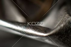 close-up view of shiny metal. - Detailed close-up image of a shiny metal.