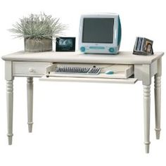 Harbor View Computer Table by Sauder. Comes in brown and bl ck, too.
