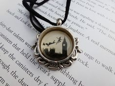 Neverland necklace. I'm not kidding, I need to have this!!