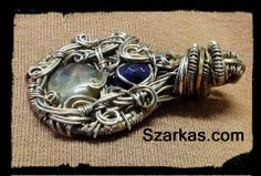 Kaos wire wrapped jewelry pendant with labradorite and sugilite in sterling. Handmade wire wrapped artisan jewelry.