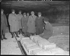General Dwight D Eisenhower, Supreme Allied commander, accompanied by General Omar N. Bradley, CG of the 12th Army Group; MG Manton Eddy, CG, XII Corps, and COL Bernard Burnstern, tours German salt mines in which stolen treasure was hidden. 4/12/45.