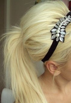 Voluminous pony tail with head band, and tease hair! I need some long hair so I can do cute things like this too!!!